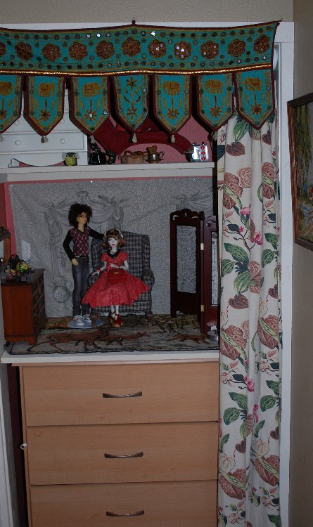 hall closet with dolls 1